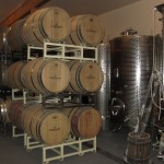 wine barrels and stainless steel tanks