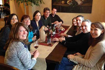 group enjoying wine